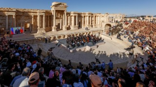 """Russian conductor Valery Gergiev leads a concert in the amphitheatre of the ancient city of Palmyra on May 5, 2016. / AFP PHOTO / Russian Defence Ministry / Olga Balashova / RESTRICTED TO EDITORIAL USE - MANDATORY CREDIT """"AFP PHOTO / Russian Defence Ministry / Olga Balashova - NO MARKETING NO ADVERTISING CAMPAIGNS - DISTRIBUTED AS A SERVICE TO CLIENTS"""