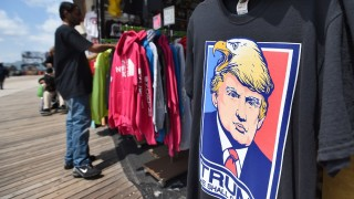 A T-shirt with a picture depicting US Republican presidential candidate Donald Trump is seen at a shop on the boardwalk in Atlantic City, New Jersey, on May 8, 2016. / AFP PHOTO / Jewel SAMAD