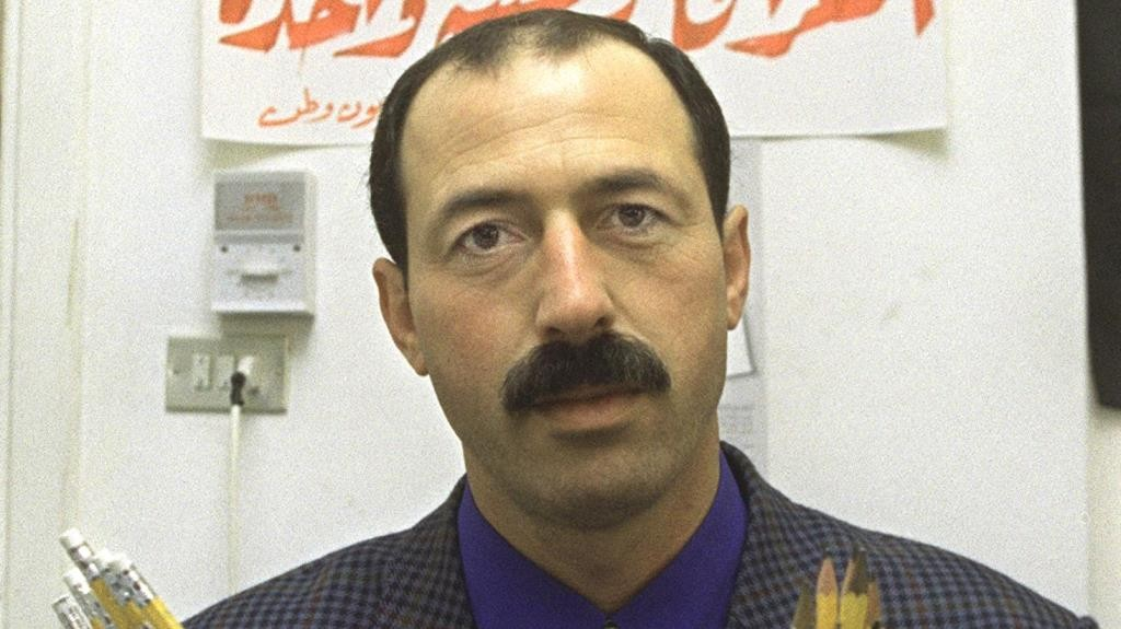 Palestinian Omar Nazzal, director of the Watan TV station in the West Bank town of Ramallah, who will head a Palestinian delegation to Iraq today, displays in Amman 12 March 2000 pencils donated by Palestinian prisoners held in Israeli jails. The pencils are among a one-million-pencil consignement bought in Jordan for Iraqi schoolchildren and heading today for Baghdad in a renewed Arab effort to break UN-imposed sanctions against Iraq.  / AFP PHOTO / JAMAL NASRALLAH