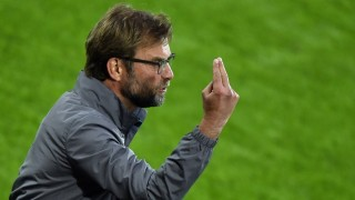 Liverpool's German head coach Jurgen Klopp  gestures during the UEFA Europa League final football match between Liverpool FC and Sevilla FC at the St Jakob-Park stadium in Basel, on May 18, 2016.   AFP PHOTO / FABRICE COFFRINI / AFP PHOTO / FABRICE COFFRINI