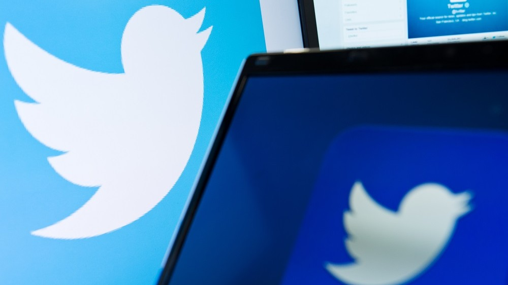 (FILES) This file photo taken on September 11, 2013 shows the logo of social networking website 'Twitter' is displayed on a computer screen in London. Twitter plans to let people fire off links or pictures without eating into the 140-character limit set for posts at the one-to-many messaging service, Bloomberg reported on May 16, 2016. The change could take place by the end of this month, according to a Blomberg report that cited someone familiar with the matter.  / AFP PHOTO / LEON NEAL