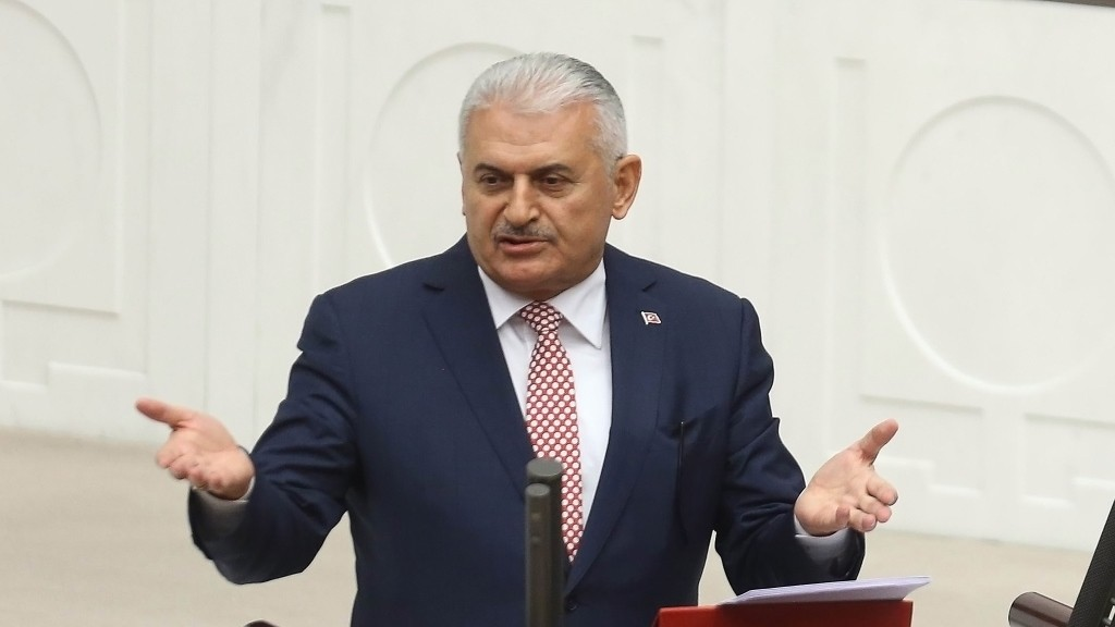 Turkish Prime Minister Binali Yildirim presents Turkey's 65th government's program to the Grand National Assembly of Turkey (TBMM) in Ankara, on May 24, 2016.  / AFP PHOTO / ADEM ALTAN