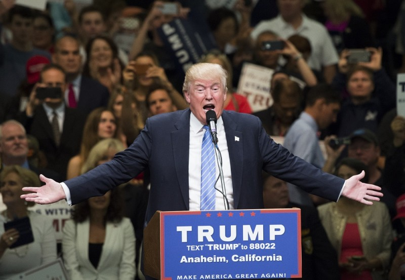 """Presumptive Republican presidential candidate Donald Trump speaks at a campaign rally, May 25, 2016 in Anaheim, California.  Donald Trump said that if he is elected US president he would support the Canadian Keystone oil pipeline project that was blocked by President Barack Obama on environmental grounds.Speaking just after he won enough primary delegates to seize the Republican nomination for the White House, Trump told reporters that the project for a new pipeline to carry Canadian crude to the Gulf of Mexico """"should be approved."""" / AFP PHOTO / ROBYN BECK"""