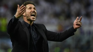 Atletico Madrid's Argentinian coach Diego Simeone celebrates after Real Madrid won the UEFA Champions League final football match between Real Madrid and Atletico Madrid at San Siro Stadium in Milan, on May 28, 2016. / AFP PHOTO / PIERRE-PHILIPPE MARCOU
