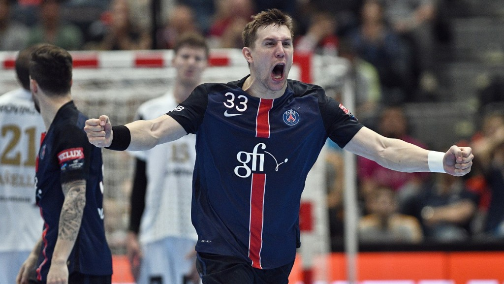 Paris's Sergiy Onufryienko celebrates during the Handball EHF Champions League final Four semifinal match between Paris St-Germain and THW Kiel in Cologne, western Germany, on May 29, 2016. / AFP PHOTO / SASCHA SCHUERMANN