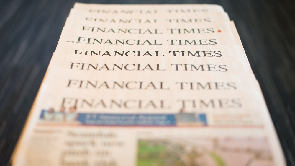This illustrative picture taken in London, England on December 11, 2012 shows copies of the Financial Times newspaper.  British publisher Pearson said on December 11, 2012  that its flagship business newspaper The Financial Times was not for sale, in response to recent media speculation.  AFP PHOTO/Leon Neal / AFP PHOTO / LEON NEAL