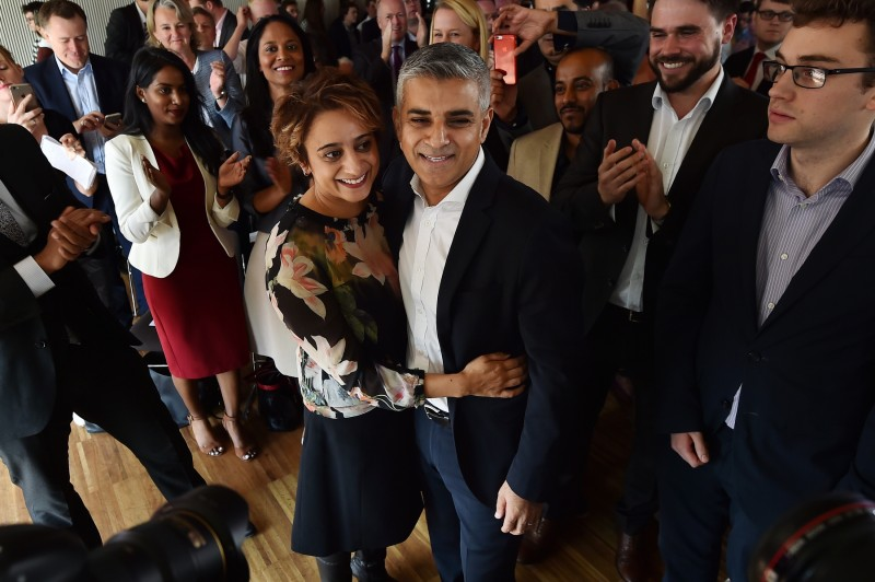 British Labour Party politician Sadiq Khan (CR) embraces his wife Saadiya (CL) after being selected to be Labour's candidate for the 2016 London mayoral election in London on September 11, 2015. London could get its first Muslim mayor after the main opposition Labour party selected Sadiq Khan, a bus driver's son and former government minister, as its candidate. AFP PHOTO / BEN STANSALL / AFP PHOTO / BEN STANSALL
