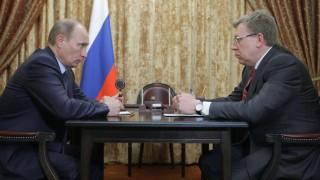 February 28, 2011. Russian Prime Minister Vladimir Putin, left, meets Finance Minister Aleksei Kudrin.