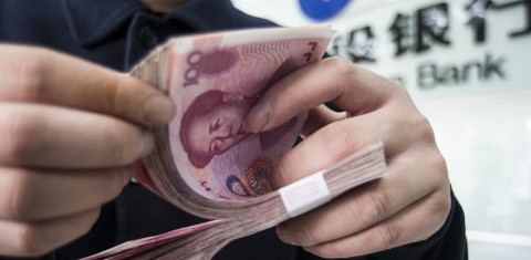 --FILE--A Chinese clerk counts RMB (renminbi) yuan banknotes at a bank in Nantong city, east China's Jiangsu province, 1 March 2016.  The UK unseated Southeast Asian financial hub Singapore as the largest clearing centre for the renminbi outside of greater China in March, according to Swift's RMB tracker. The financial transaction system's data showed the value of UK renminbi payments rose 21 per cent year-on-year in March. The jump reflects the growing dominance of China's currency in payments between the UK and China/Hong Kong, which now accounts for 40 per cent of all payments in the corridor, followed by the Hong Kong dollar (24 per cent).
