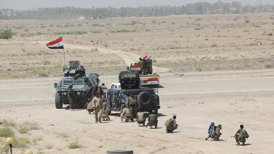AL-ANBAR, IRAQ - JULY 12: Military vehicles belonging to the Iraqi security forces and Shia Hashdi Shabi forces before attacking Falluja in Al-Anbar Province with heavy weapons in order to liberate it from Daesh on July 12, 2015. Ali Mohammed / Anadolu Agency
