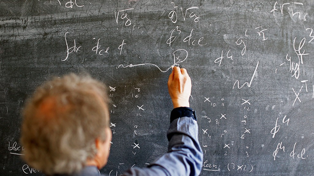GENEVA, SWITZERLAND - APRIL 19:  Alberto Ramos (not in frame), Theoretical Physics Fellow and visitor, Antonio Gonzalez-Arroyo from the Universidad Autonoma de Madrid talk and make notes on the blackboard with chalk with theoretical physics equations at The European Organization for Nuclear Research commonly know as CERN on April 19, 2016 in Geneva, Switzerland.  (Photo by Dean Mouhtaropoulos/Getty Images)