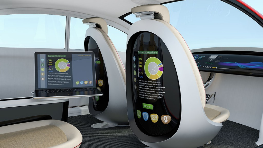 Autonomous car interior concept. Rear screen of front passenger seat display business document, and laptop on the side table show same document. Concept for new business work style in future. 3D rendering image with clipping path.
