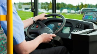 Bus driver sitting in his bus on tour