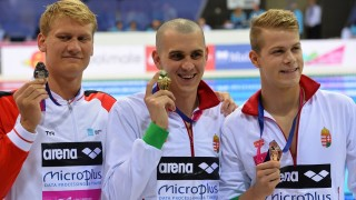 Gold medalist Hungary's Laszlo Cseh (C), silver medalist Denmark's Viktor Bromer (L) and bronze medalist Hungary's Tamas Kenderesi pose with their medals after the final of the men's 200m Butterfly swimming event on Day 11 of the European aquatics championships in London on May 19, 2016. / AFP PHOTO / GLYN KIRK