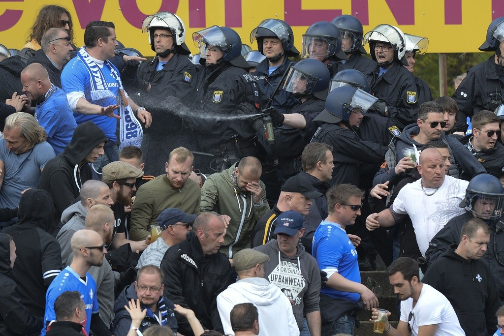 Clashes between police and spectators during the closing stages of the game during the German Bundesliga game between SV Darmstadt 98 vs. Eintracht Frankfurt in Darmstadt, Germany, 30 April 2016. Frankfurt won 2:1. Photo. ROLAND HOLSCHNEIDER/DPA