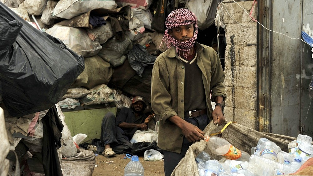 SANAA, YEMEN - FEBRUARY 14: A Yemeni man, collects garbages to recycle to earn money, is seen inside dumps in Sanaa, Yemen on February 14, 2015. UNICEF had announced that 14,7 million of people need help in Yemen. (Photo by Mohammed Hamoud/Anadolu Agency/Getty Images)