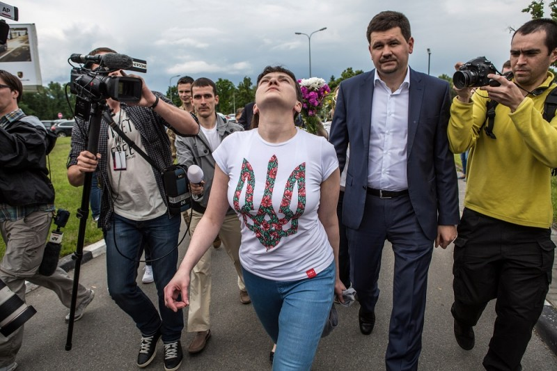 BORYSPIL, UKRAINE - MAY 25: Ukrainian military pilot Nadiya Savchenko is surrounded by media upon her arrival at Kyiv Boryspil Airport on May 25, 2016 in Boryspil, Ukraine. Savchenko was captured while fighting Russia-backed rebels in eastern Ukraine and put on trial in Russia on charges that she was complicit in the deaths of two Russian journalists. In March she was convicted and sentenced to 22 years in prison, but was reportedly swapped for two Russian fighters captured by Ukrainian forces. (Photo by Brendan Hoffman/Getty Images)