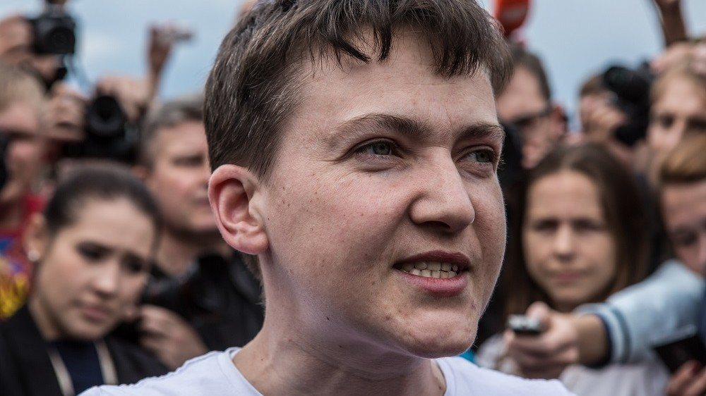 BORYSPIL, UKRAINE - MAY 25: Ukrainian military pilot Nadiya Savchenko is surrounded by media upon her arrival at Kyiv Boryspil Airport on May 25, 2016 in Boryspil, Ukraine. Savchenko was captured while fighting Russia-backed rebels in eastern Ukraine and put on trial in Russia on charges she was complicit in the deaths of two Russian journalists. In March she was convicted and sentenced to 22 years in prison, but was reportedly swapped for two Russian fighters captured by Ukrainian forces. (Photo by Brendan Hoffman/Getty Images)
