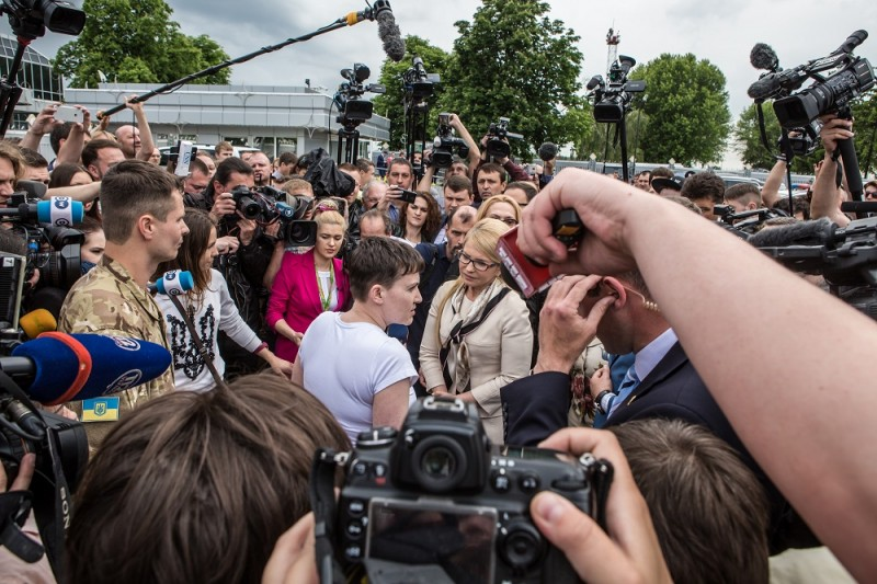 BORYSPIL, UKRAINE - MAY 25: Ukrainian military pilot Nadiya Savchenko greets Yulia Tymoshenko, a member of parliament and leader of the Fatherland Party, upon her arrival at Kyiv Boryspil Airport on May 25, 2016 in Boryspil, Ukraine. Savchenko was captured while fighting Russia-backed rebels in eastern Ukraine and put on trial in Russia on charges she was complicit in the deaths of two Russian journalists. She was elected to parliament as a member of the Fatherland Party while being held in Russia, and in March she was convicted and sentenced to 22 years in prison, but was reportedly swapped for two Russian fighters captured by Ukrainian forces. (Photo by Brendan Hoffman/Getty Images)