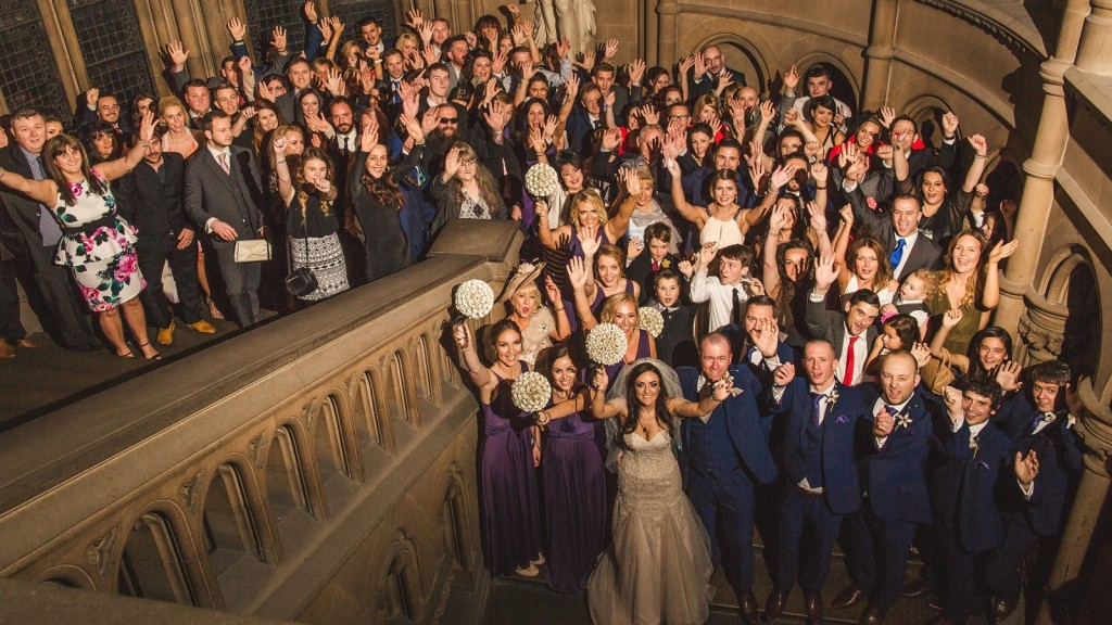 All the guests celebrate at Cassie and Lewis Byrom's Harry Potter themed wedding. See SWNS story SWPOTTER: Magic was definitely in the air for this bride and groom who tied the knot in the ultimate HARRY POTTER-themed wedding. Newlyweds, Cassie, 31, and Lewis Byrom, 34, are such big fans of the JK Rowling novels that their wedding was completely styled around the famous books. The couple even got engaged in the legendary Diagon Alley, after Lewis surprised Cassie with a letter accepting her into The Hogwarts School of Witchcraft and Wizardry for her 30th birthday. Inside the envelope were two tickets to Harry Potter World at Universal Studios in Orlando, Florida, where Lewis got down on one knee.