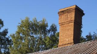 Bricks chimney on the roof