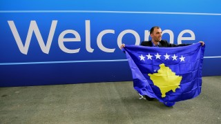 A delegation member of Kosovo celebrates the UEFA membership admission after the 40th Ordinary UEFA Congress at the Hungexpo Fair Center in Budapest, Hungary, on May 3, 2016. / AFP PHOTO / ATTILA KISBENEDEK