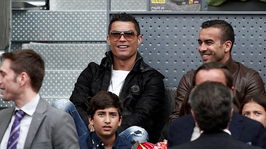 MADRID, SPAIN - MAY 6: Cristiano Ronaldo (C) football player  of Real Madrid watches Rafael Nadal of Spain and Joao Sousa of Portugal quarter final round match at the Mutua Madrid Open tennis tournament at the Caja Magica in Madrid, Spain on May 06, 2016.  Burak Akbulut / Anadolu Agency