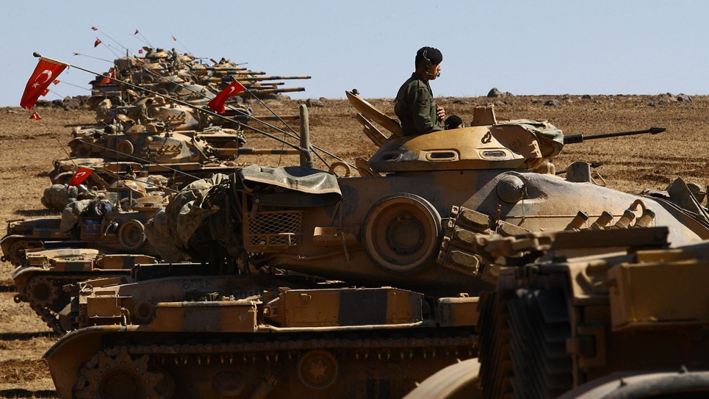 SANLIURFA, TURKEY - OCTOBER 06: Tanks of Turkish Armed Forces are seen on the hills at the Turkey - Syria borderline in the Suruc district of Sanliurfa Turkey, as the clashes between the Islamic State of Iraq and the Levant (ISIL) and Kurdish armed groups continue in Ayn al-Arab city (Kobani) on October 6, 2014. (Photo by Ensar Ozdemir/Anadolu Agency/Getty Images)