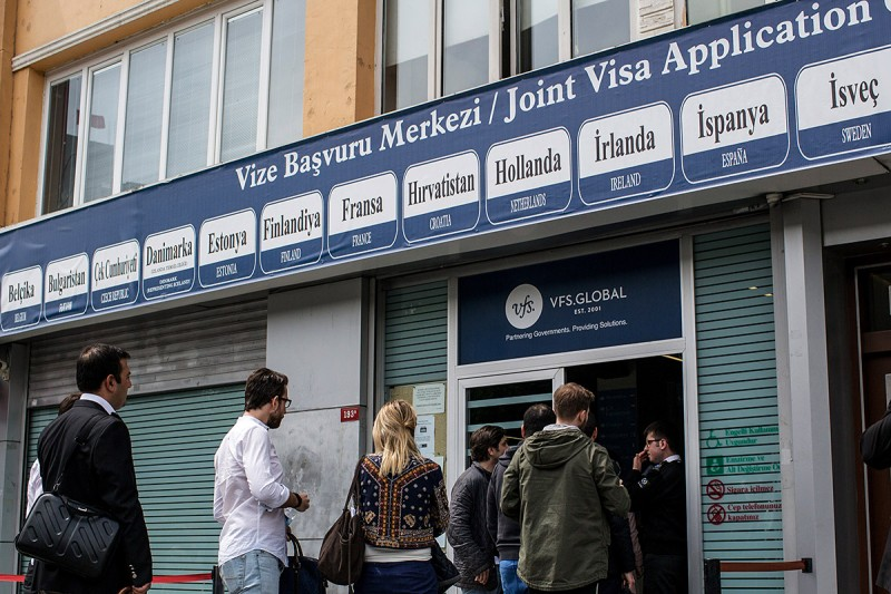 ISTANBUL, TURKEY - MAY 04:  People wait outside a Joint Visa Application center to apply for a Schengen visa on May 4, 2016 in Istanbul, Turkey. The European Commission today recommended Turkish citizens be granted visa free travel for short stay, business and tourist trips to Europe's Schengen area, as part of the EU-Turkey migrant deal. EU member states and the European Parliament are set to vote on the visa deal in June. (Photo by Chris McGrath/Getty Images)