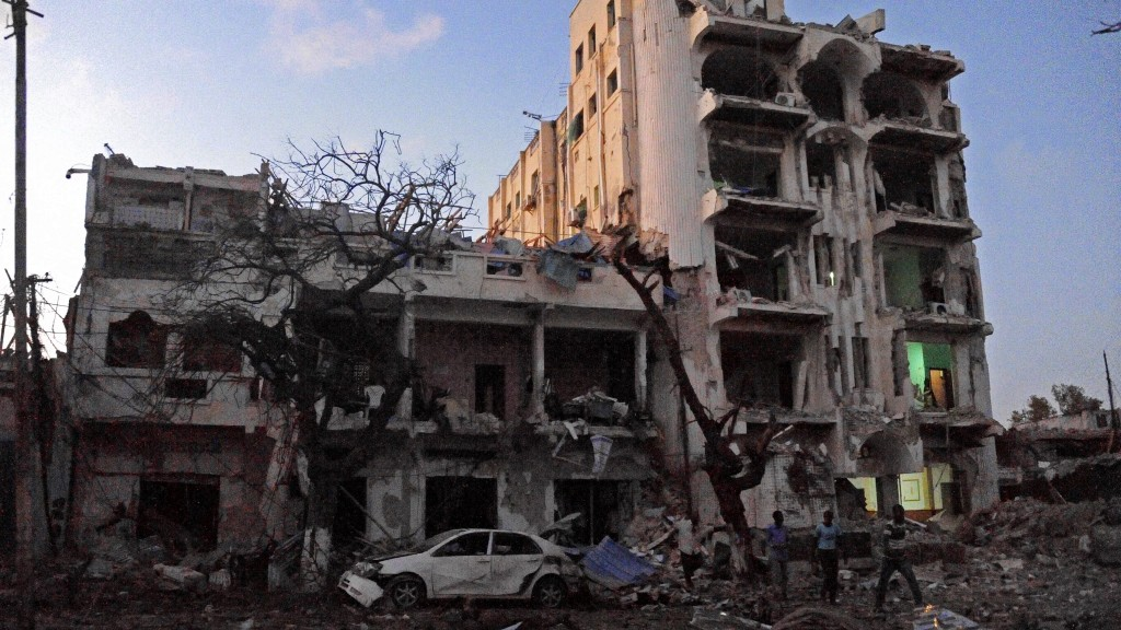 A picture taken on June 1, 2016 shows the scene of a terror attack at the Ambassador Hotel, after a car bomb exploded at a top Mogadishu hotel that houses several MPs, killing several people, and followed by a gun battle. Somalia's Al-Qaeda-linked al-Shabaab group was chased out of the capital Mogadishu in 2011 but remains a dangerous threat in both Somalia and neighbouring Kenya, where it carries out frequent attacks / AFP PHOTO / MOHAMED ABDIWAHAB