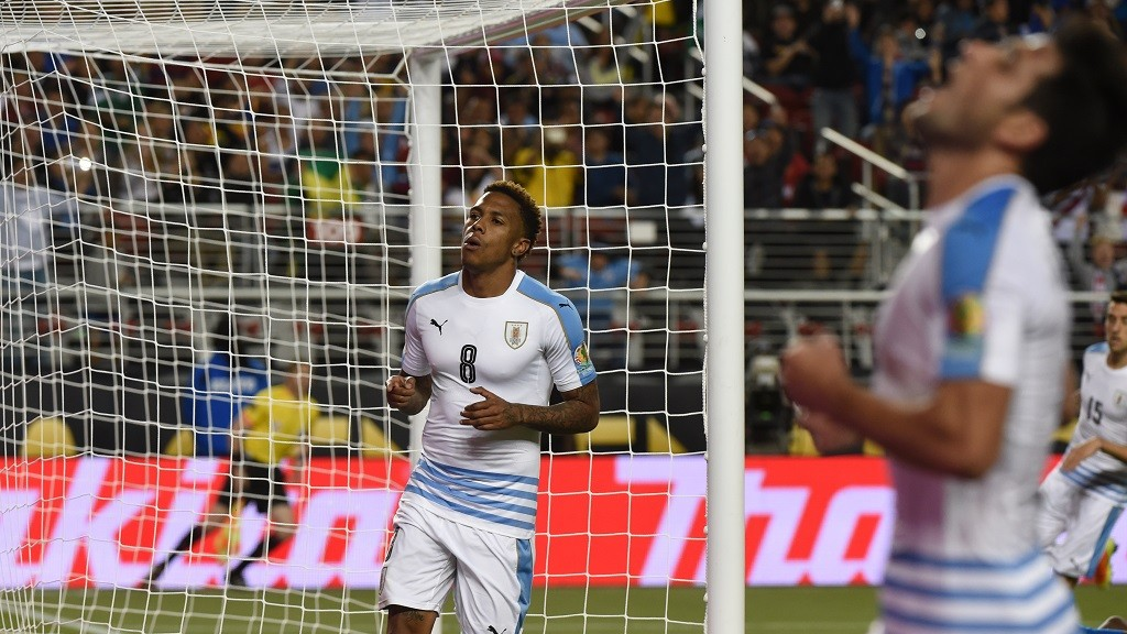 Uruguay's Abel Hernandez (L) and Nicolas Lodeiro celebrate an own-goal by Jamaica's Je-Vaughn Watson during their Copa America Centenario football tournament match in Santa Clara, California, United States, on June 13, 2016.  / AFP PHOTO / Mark RALSTON