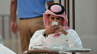 TO GO WITH AFP STORY BY WISSAM KEYROUZ A Saudi man checks his mobile at a coffee shop in the capital Riyadh on June 17, 2013. In the United Arab Emirates and all across the conservative Gulf countries dating is unacceptable while arranged marriages are the norm, so to beat the segregation imposed by a stern society, young men and women meet virtually. AFP PHOTO/FAYEZ NURELDINE / AFP PHOTO / FAYEZ NURELDINE