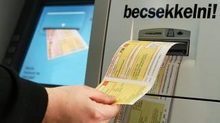 Image: 73189023, Sárga csekk – elfogadása, befizetése bankjegykiadó automatán (ATM-en) keresztül., Place: Budapest, Hungary, License: Rights managed, Model Release: No or not aplicable, Property Release: Yes, Credit: smagpictures.com