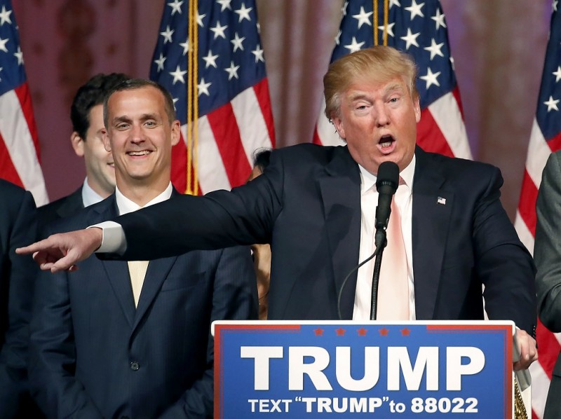(FILES) This file photo taken on March 15, 2016 shows Republican presidential candidate Donald Trump with his campaign manager Corey Lewandowski(L) addressing the media following victory in the Florida state primary in West Palm Beach, Florida.  Republican presidential hopeful Donald Trump on June 20, 2016 shook up his White House bid as he looks to a November showdown with Hillary Clinton, letting go his controversial campaign manager. Corey Lewandowski -- who had led the real estate mogul's campaign from the start and was credited with Trump's initial breakthrough in the primaries -- has recently been sidelined, with more experienced political operatives taking over in the run-up to November 8. Lewandowski courted controversy earlier this year over a March run-in with a reporter at a Trump rally. She accused him of roughly grabbing her, leaving bruises, but he denied that account. Florida prosecutors opted to drop all charges.  / AFP PHOTO / RHONA WISE