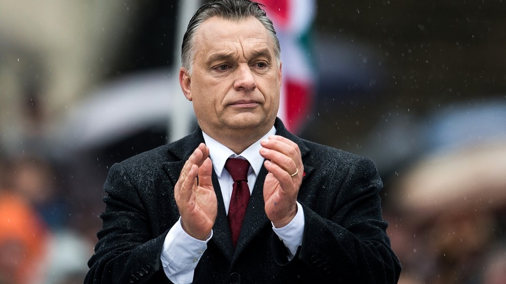 Viktor Orban, Hungary's prime minister, applauds during an official address, outside the National Museum of Hungary in Budapest, Hungary, on Tuesday, March 15, 2016. Hungary won't allow the European Union to force member states to accept refugees, Orban said. Photographer: Akos Stiller/Bloomberg via Getty Images