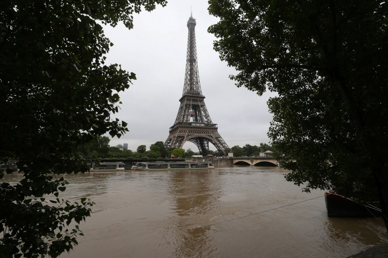 PARIS, FRANCE - JUNE 03:  Boats float as the Seine river rises near the area of the Effeil tower as the Seine river's embankments overflow after seven days of heavy rain on June 3, 2016 in Paris, France.  (Photo by Xavier Laine/Getty Images)