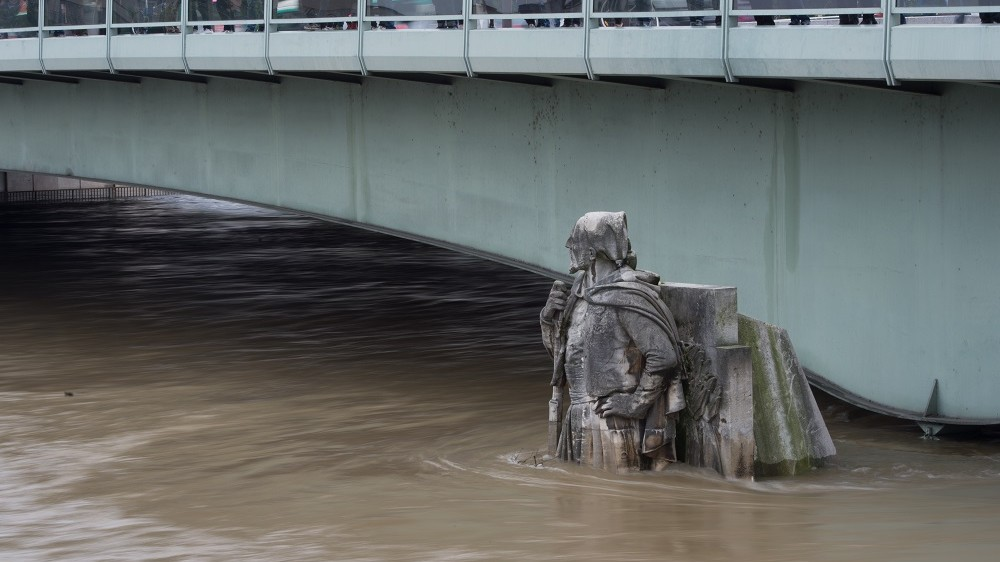 PARIS, FRANCE - JUNE 03:  Zouave statue in front of the Alma bridge as the Seine river's embankments overflow after three days of heavy rain on June 3, 2016 in Paris, France. Northern France is experiencing wet weather causing flooding in parts of France, particularly Paris where the French Open has had delays in matches.  (Photo by Thierry Orban/Getty Images)