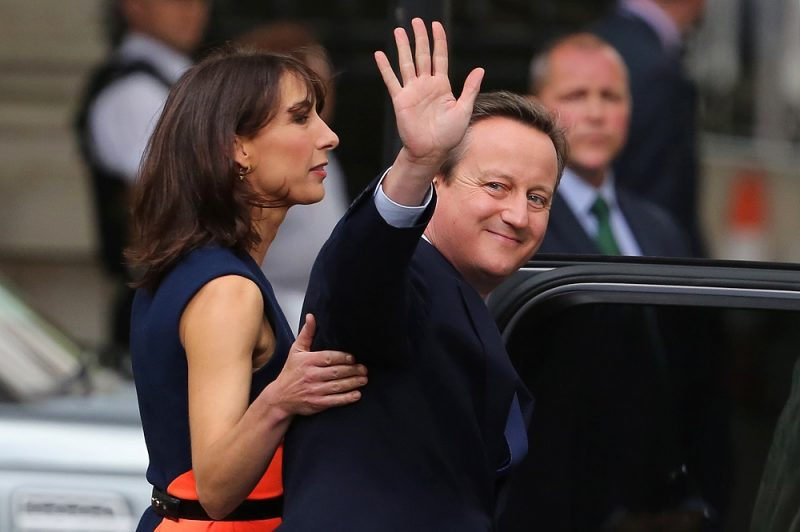 Samantha Cameron (L) stands with her husband, outgoing British prime minister David Cameron (R) as he waves after speaking outside 10 Downing Street in central London on July 13, 2016 on his way to Buckingham Palace to tender his resignation to Queen Elizabeth II.  Outgoing British prime minister David Cameron urged his successor Theresa May on Wednesday to maintain close ties with the EU even while negotiating to leave it, as he paid a fond farewell to MPs hours before leaving office. Cameron will tender his resignation on July 13 to Queen Elizabeth II at Buckingham Palace, after which the monarch will task the new leader of the Conservative Party Theresa May with forming a government.  / AFP PHOTO / Geoff CADDICK