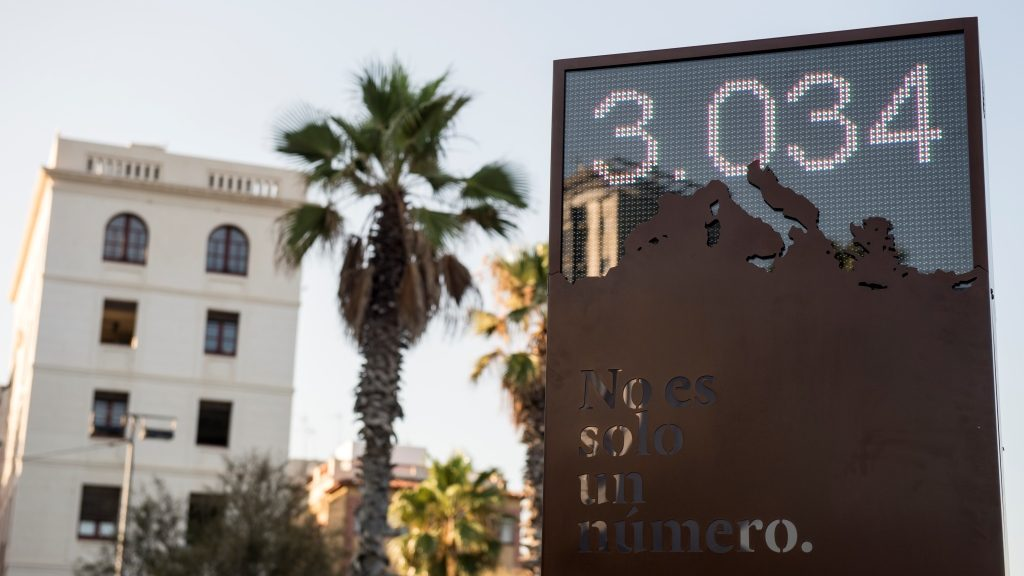 """Picture shows a digital billboard that counts the number of refugees who have died in the Mediterranean sea, named """"the shame counter"""", during its inauguration under the slogan """"We are and we will be a refuge city"""" in Barcelona on July 28, 2016.  / AFP PHOTO / JOSEP LAGO"""