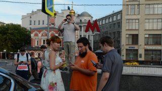 2897974 07/23/2016 Young people play Pokemon Go from Nintendo on their mobile phones outside Kitay gorod metro station, Moscow. Valeriy Melnikov/Sputnik