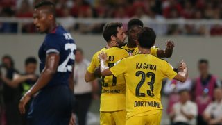 Players of Borussia Dortmund celebrate after Pierre-Emerick Aubameyang scored a goal by a penalty shot against Manchester United during the Shanghai match of the 2016 International Champions Cup at the Shanghai Stadium in Shanghai, China, 22 July 2016.