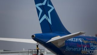 An Air Transat aircraft sits at Toronto Pearson International Airport in Toronto on Wednesday July 3, 2013.  Photographer: Brent Lewin/Bloomberg