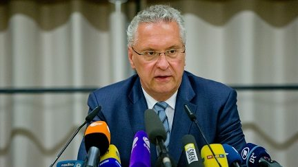 Bavarian Interior minister Joachim Herrmann (R) attends a press conference on July 25, 2016 in Ansbach following an attack by a Syrian refugee during a music festival.  A Syrian migrant set off an explosive device near an open-air music festival in southern Germany that killed himself and wounded a dozen others, authorities said Monday, the third attack to hit the region in a week. / AFP PHOTO / dpa / Daniel Karmann / Germany OUT