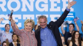 (FILES) This file photo taken on July 14, 2016 shows  US Democratic Presidential candidate Hillary Clinton and US Senator Tim Kaine, Democrat of Virginia, waving during a campaign rally at Ernst Community Cultural Center in Annandale, Virginia. Clinton is expected to reveal her vice presidential pick by July 23, when she campaigns in Florida. Kaine is mentioned first in virtually ever veepstakes discussion because he ticks so many boxes: strong foreign policy experience (he is on the armed services and foreign relations committees); loyal lawmaker from a battleground state; Spanish-speaker.  / AFP PHOTO / SAUL LOEB
