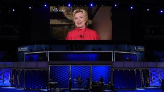 Democratic presidential nominee Hillary Clinton addresses the second evening session of the Democratic National Convention from a screen at the Wells Fargo Center, July 26, 2016 in Philadelphia, Pennsylvania.      / AFP PHOTO / SAUL LOEB