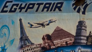 CAIRO, EGYPT - MAY 23:  An advert promoting EgyptAir is seen on the outside of a travel agency on May 23, 2016 in Cairo, Egypt. Egypt's tourism industry has struggled to recover since the uprising in 2011, the ISIS attack on a Russian metro jet and the hijacking of an EgyptAir flight in March.  Despite last weeks crash of EgyptAir flight MS804  Egypt's Tourism Minister Yehia Rashed said in a statement on Sunday he hoped the country would attract 12 million tourists back by the end of 2017. Egyptian President Abdel Fattah el-Sisi announced Sunday that a submarine will be deployed to search for the flights 'black box'. The submarine can reach depths of 3,000 meters. EgyptAir flight MS804 crashed into the Mediterranean Sea en-route to Cairo from Paris carrying 66 passengers and crew. Wreckage including seats, personal belongings and human remains have been located 290kilometres north of Egypts port city of Alexandria and data taken from the aircrafts ACARS system show several smoke alerts near the cockpit just minutes before the flight crashed.  (Photo by Chris McGrath/Getty Images)