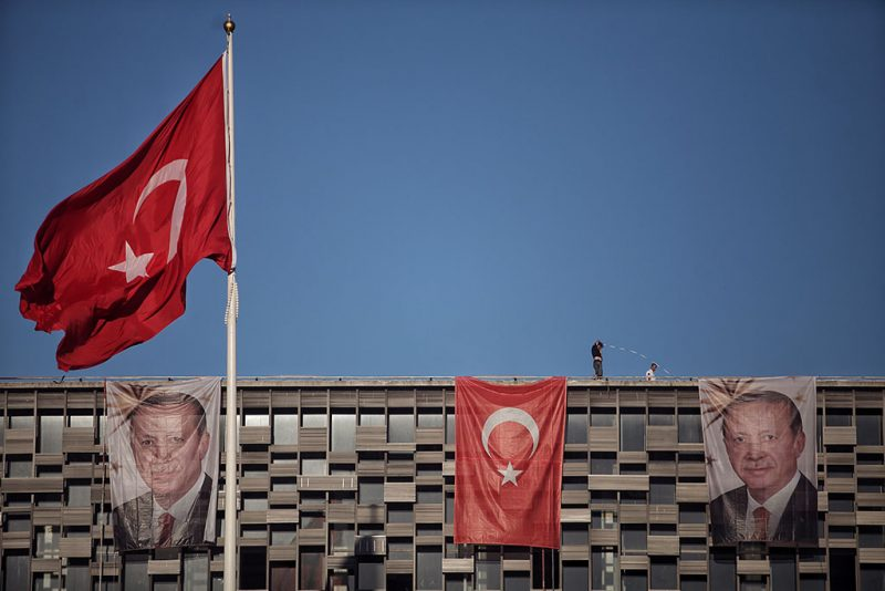 ISTANBUL, TURKEY - JULY 19: Posters of Turkey's President Recep Tayyip Erdogan and a Turkish flag hangs on Ataturk Cultural Center at Istanbul's central Taksim on July 19, 2016 in Istanbul, Turkey. Clean up operations are continuing in the aftermath of Friday's failed military coup attempt. Latest figures according to Turkey's Prime Minister Binali Yildirim raises the death toll to 232 with 1491 wounded. Continuing raids across the country have seen 9,322 people detained and 316 arrested including high ranking soldiers, judges and police officers. (Photo by Kursat Bayhan/Getty Images)