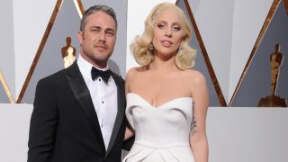 HOLLYWOOD, CA - FEBRUARY 28:  Singer/actress Lady Gaga and actor Taylor Kinney arrive at the 88th Annual Academy Awards at Hollywood & Highland Center on February 28, 2016 in Hollywood, California.  (Photo by Gregg DeGuire/WireImage)