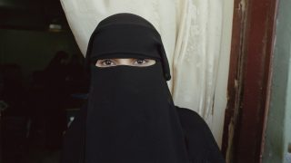 A woman wearing a niqab in Aden, Yemen, 2004. (Photo by Scott Wallace/Getty Images)