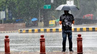 NEW DELHI, INDIA - JULY 8: A man uses an umbrella to protect himself from Monsoon rains on July 8, 2016 in New Delhi, India. Rains hit several parts of the national capital which kept the temperature within comfortable levels even as water-logging led to traffic snarls at some places. (Photo by Geetika Bhandari/Hindustan Times via Getty Images)